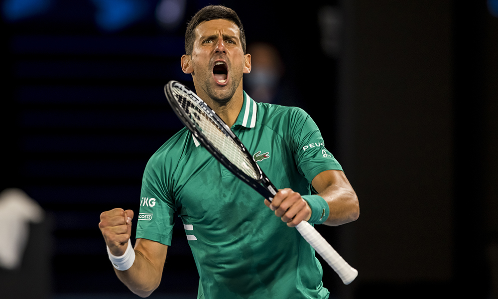 Novak Djokovic celebrates Australian Open